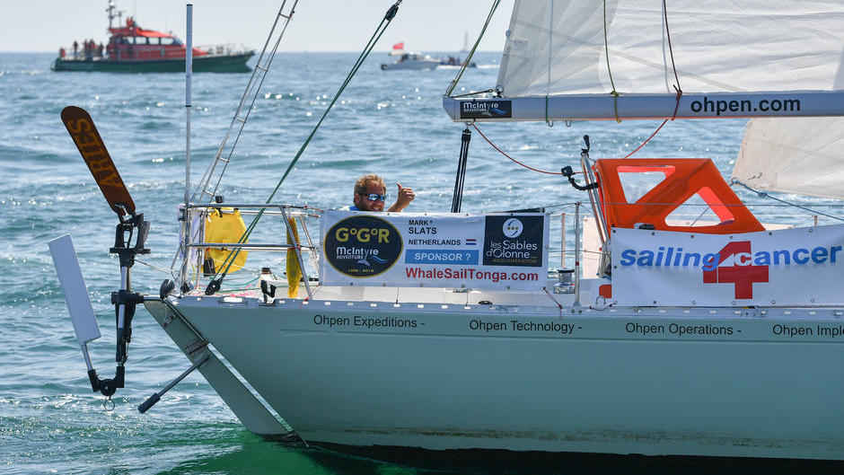PPL PHOTO AGENCY - COPYRIGHT FREE for editorial use onlyPHOTO CREDIT: Christophe Favreau/PPL/GGRTel: +44(0)7768 395719 E.mail: ppl@mistral.co.ukweb: www.pplmedia.com ***2018 Golden Globe Race - start of Race from Les Sables d'Olonne, France. Mark Slats (NED) gives the thumbs up from his Rustler 36 Ophen Maverick.