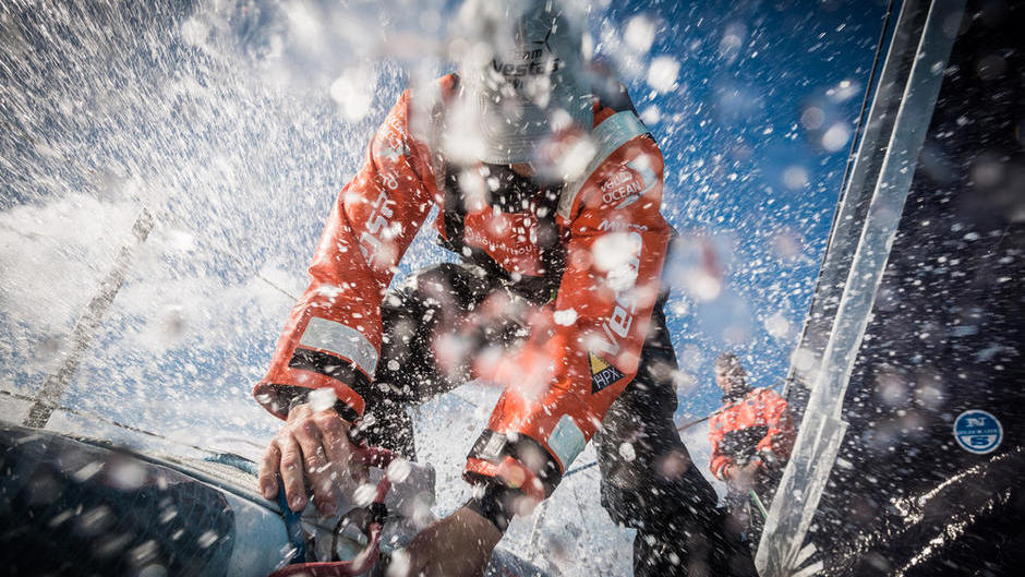October 26, 2014. Leg 1 onboard Team Vestas Wind. Nicolai Sehested buried beneath wave during a headsail change. Day 15 at Sea.